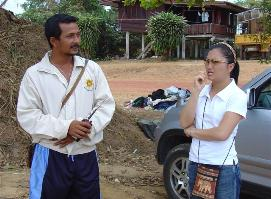 Maitree (head man) and Waree discuss discuss plans to purchase fishing nets and tackle